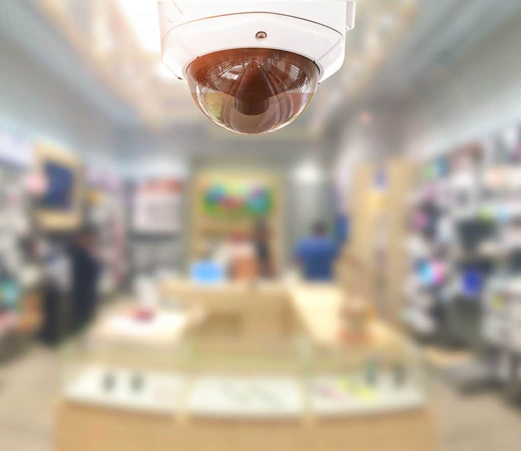 CCTV security panorama with shop store blurry background.